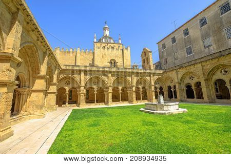 Gothic romanesque cloister of old Coimbra Cathedral and dome. Se Velha de Coimbra, is one of most important romanesque buildings in Portugal and landmark in Coimbra, north of Portugal.