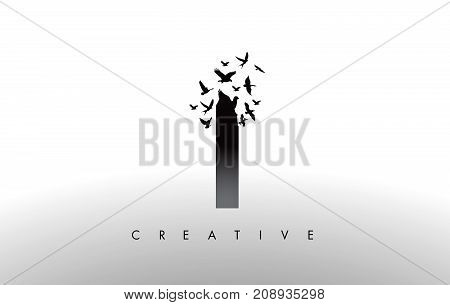 I Logo Letter With Flock Of Birds Flying And Disintegrating From The Letter.