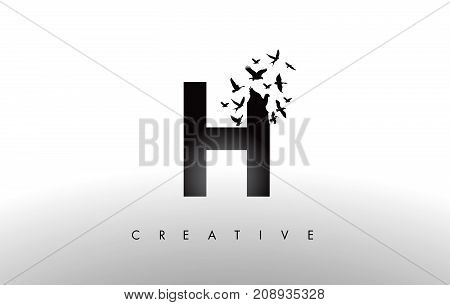 H Logo Letter With Flock Of Birds Flying And Disintegrating From The Letter.