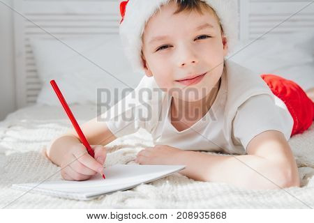 Boy In A Red Cap Writes A Letter To Santa