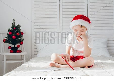 Boy Thinks About The Letter To Santa