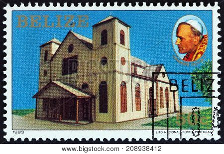 BELIZE - CIRCA 1983: A stamp printed in Belize issued for the Visit of Pope John Paul II shows church, circa 1983.