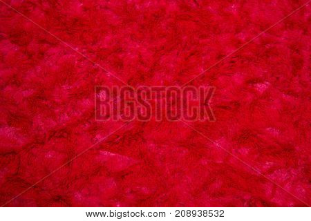 plush velor bright red color as a background, texture