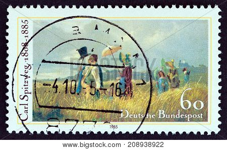 GERMANY - CIRCA 1985: A stamp printed in Germany issued for the death centenary of painter Carl Spitzweg shows Sunday Walk, circa 1985.