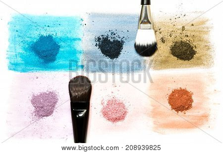 six samples of bright dry pigment with a brush isolated on white background with copyspace