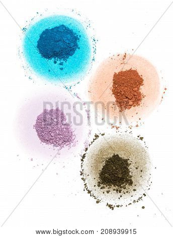 four samples of bright dry pigment in the form of a flower