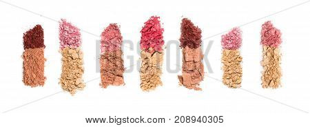 Set of seven lipsticks made from crashed face powder and blush, isolated on white background. Top view point.