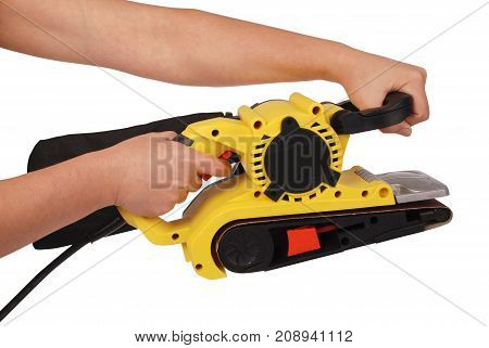Hand holds new professional finishing sander isolated on white background