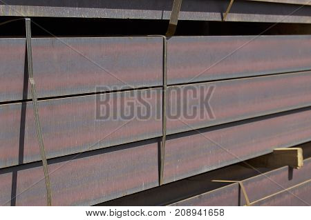 Metal profiles of different kinds are located in the metal products warehouse Russia