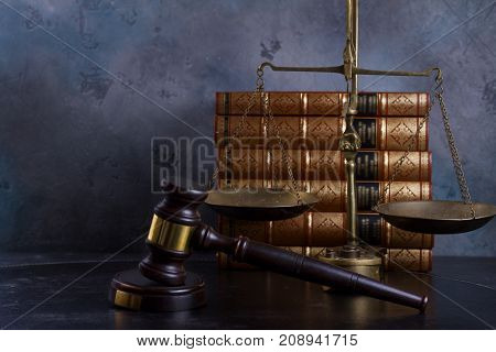 Law and justice concept - law gavel with scale and row of books
