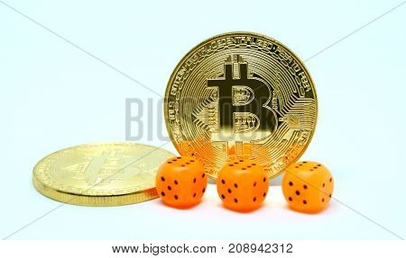 Three dice and two coin of bitcoin. Risks of invest to bitcoin. Fluctuations the rate of bitcion on market.