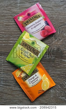 Sydney Australia - October 15 2017: Twinings three Tea Bag varieties (green fruity and spicy) on wooden surface. Twinings brand is owned by Associated British Foods.