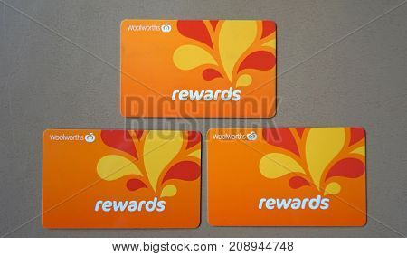 Sydney Australia - October 15 2017: Group of Woolworths Rewards loyalty cards. Woolworths Supermarkets is an Australian grocery store chain along with Coles together accounting for about 80% of the Australian market.