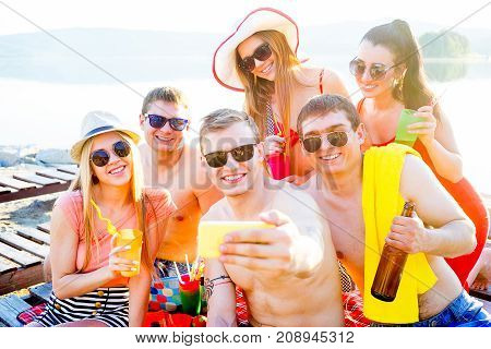 Group of friends are having a party on a beach