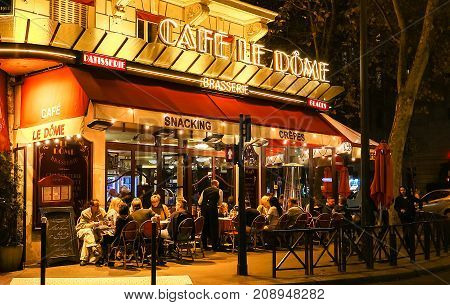 PARIS, FRANCE - OCTOBER 12, 2017: Le Dome night view, a typical French cafe located near the Eiffel tower in Paris, France.