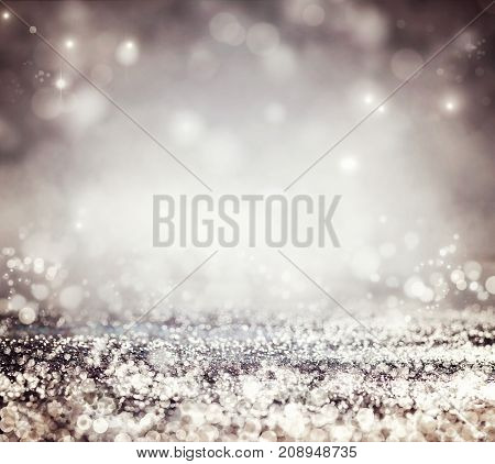 Festive background. Bokeh blurred background. Glitter vintage lights
