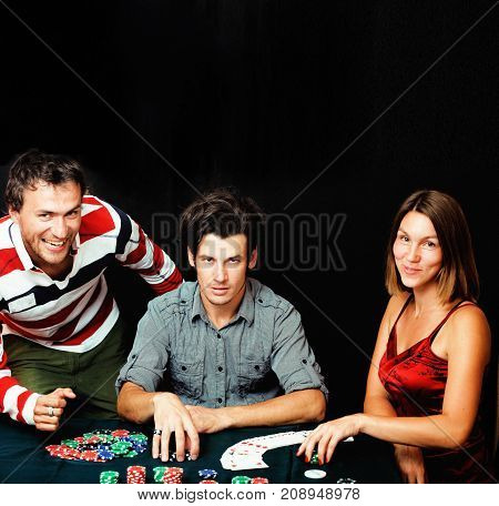 young people playing poker on black background offline