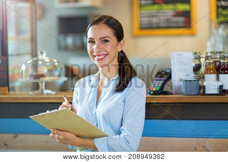 Woman working in coffee shop