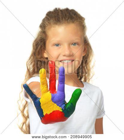Little cute girl showing painted hand on white background