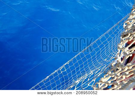 Beautiful view of water and nets from ship