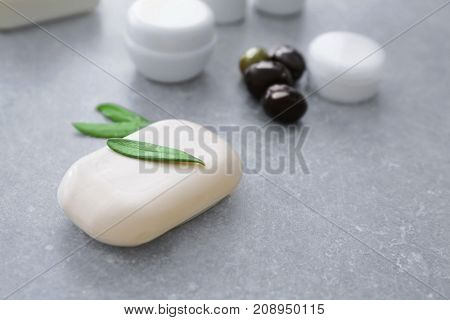 Cosmetics with olive oil extract on grunge table