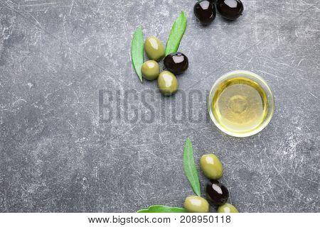 Bowl with olive oil on grunge table