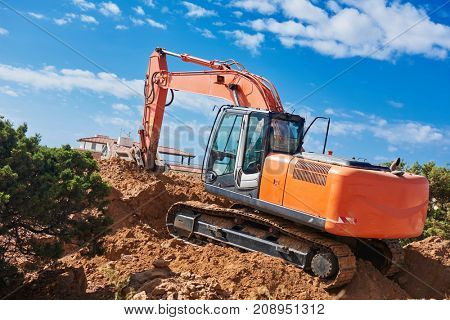 excavator loader machine at construction site