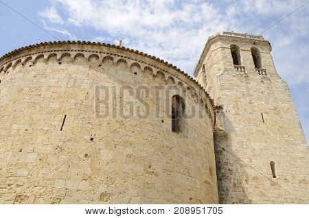Tower and circular side of the romanic church of Saint Vicent in Besalu a town in the comarca of Garrotxa in Girona Catalonia Spain.