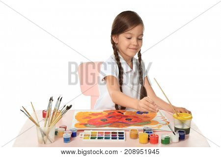 Little cute girl painting at table on white background