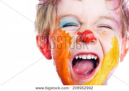 Yelling small boy with painted face