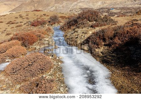 frozen water in a creek, Himalayas, Nepal
