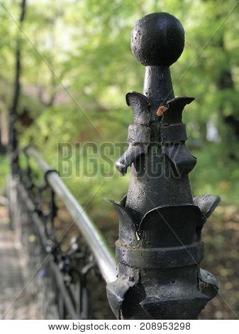metal ornaments on bridge in park
