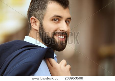 Handsome confident man in formal clothes outdoors