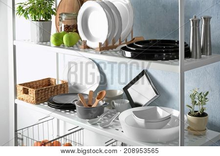 Tableware on storage stand indoors
