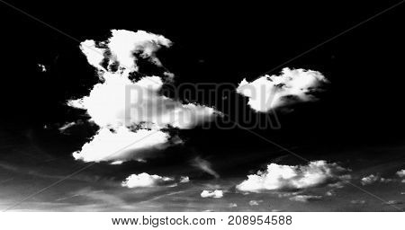 Isolated white clouds on black sky background