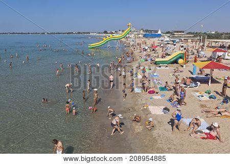 Evpatoria, Republic of Crimea, Russia - July 22, 2017: Transparent water at the beach