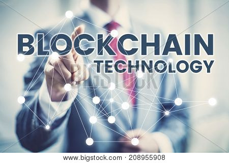 Businessman Pointing At Blockchain Technology. Cryptocurrency Concept.