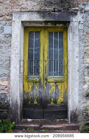 An old door in an abandoned building in the hill village of Casso in Friuli Venezia Giulia north east Italy. With a population now of only 35 the village is famous locally for having being evacuated following the 1963 Vajont Dam disaster.