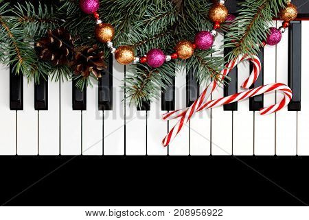 Christmas card with piano and Christmas decoration