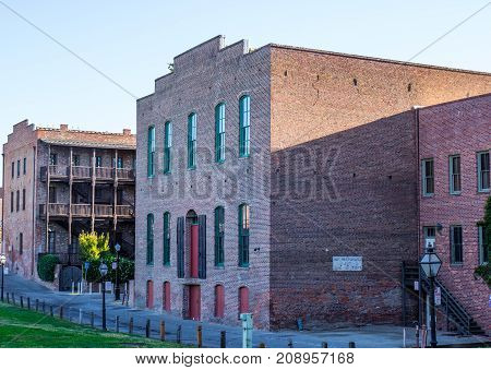 Historical Multi Story Brick Buildings With Railings