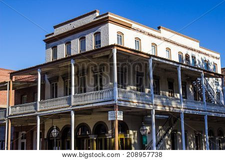 Historical Multi Story Corner Building With Wrap Around Balcony