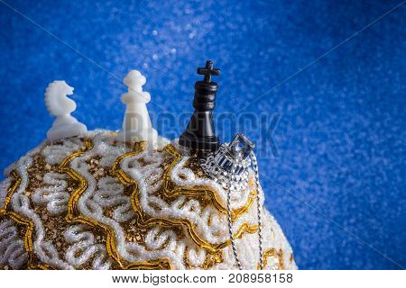 chess figures and bright Christmas decoration on a blue background