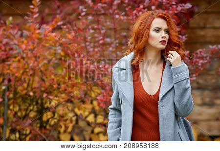 Outdoors portrait of colorful clothed gorgeous fall fashion girl.