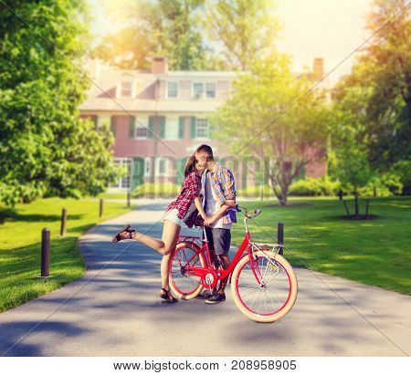 Love couple with vintage bicycle kissing in park