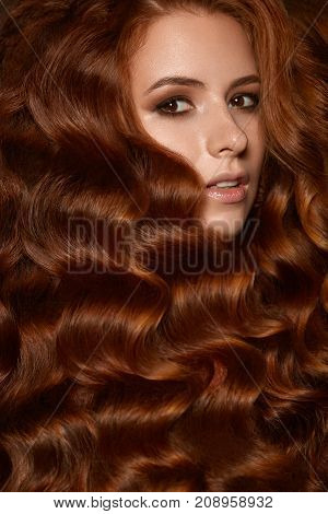 Attractive ginger woman with wave hairstyle curly in studio redhead