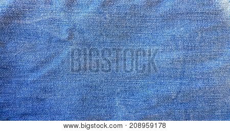 Blue background denim jeans background. Jeans texture fabric
