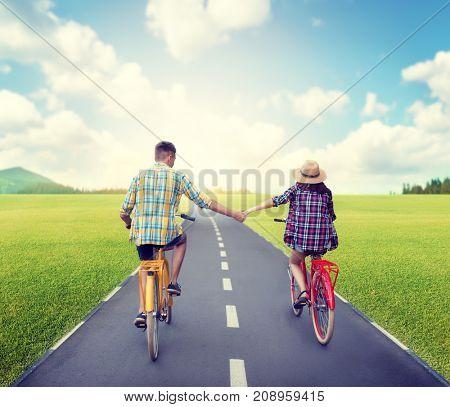 Love couple riding on vintage bikes