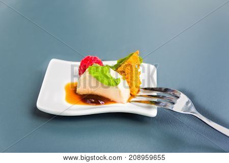 Delicious dessert or appetizer on a small white dish