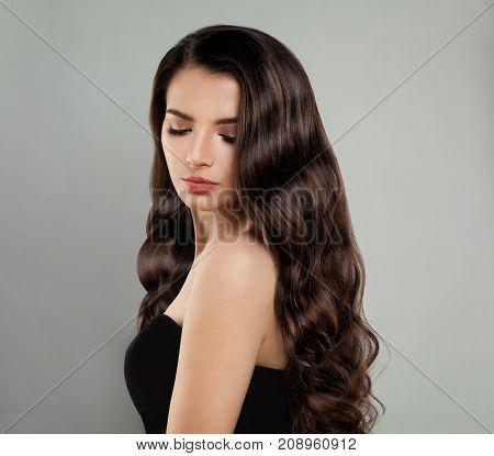 Brunette Beauty. Pretty Model Girl with Long Hair Fashion Portrait
