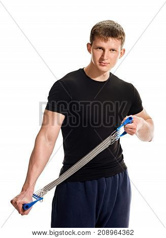Sporty strong man exercising with expander on white background